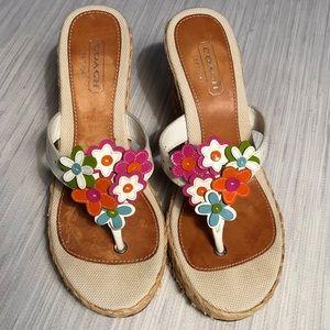 Coach flower wedge sandals.